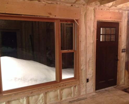 Here is a view of a finished wall insulation job we completed in the winter time in Concord NH. You can see the snow piling up outside and the col